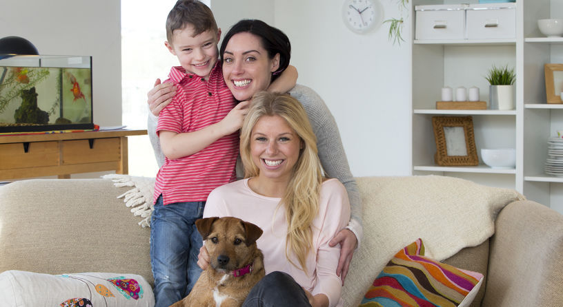 Lesbian couple with son and dog